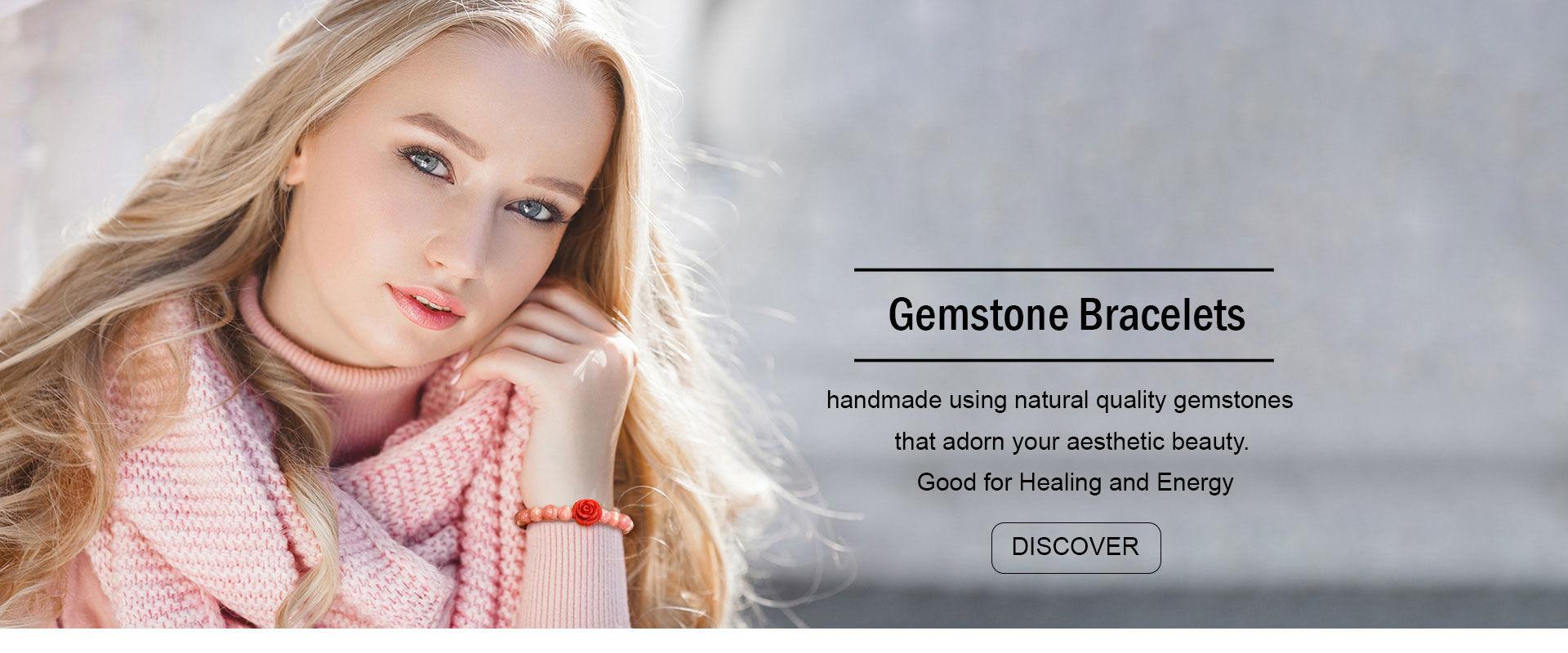 woman wearing a red stone healing bracelet